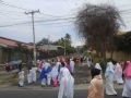 The procession starts outside of COAR, carrying the cross